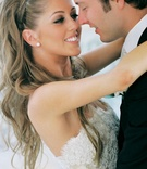 Bride hugs groom with long blonde hair and nice makeup