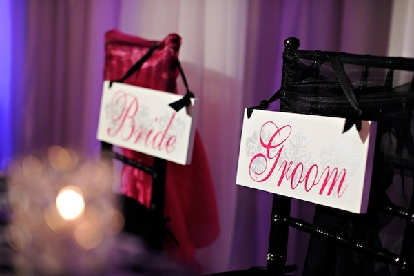 Pink and black canvas signs with damask