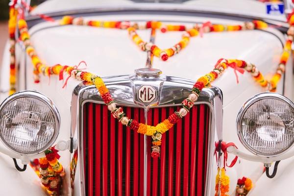 classic car wedding getaway car with flowers on it