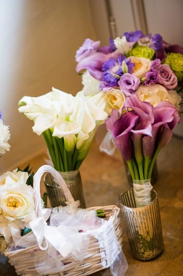 Bouquets of white and pink lilies and bouquet of purple, green and white flowers