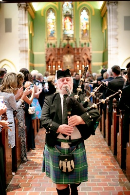 scottish bagpiper down the aisle for wedding recessional