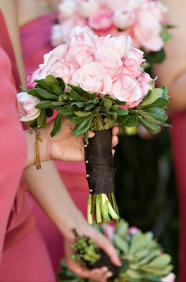 Bridesmaid carrying single flower nosegay