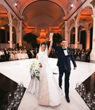 Bride and groom announced husband and wife ceremony seating in the round vibiana columns white stage