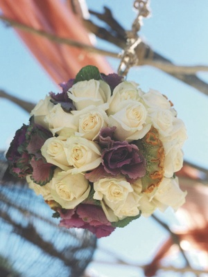 Ball of flowers hanging from ceremony structure