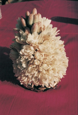 Centerpiece of white flowers and flower buds
