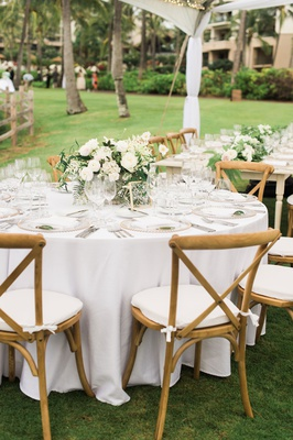 wedding reception round white table tent wedding low centerpiece greenery vineyard wood chair white