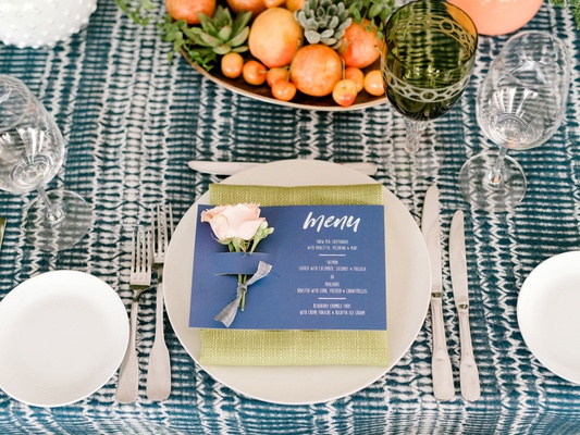 rooftop bridal shower lime green napkin blue menu card pink rose bowl of succulents and fruit green