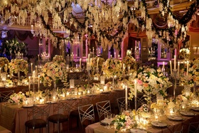 Long banquet tables topped with tall floral arrangements