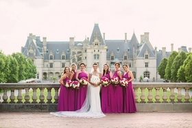 Magenta fuchsia bridesmaid dresses in front of Biltmore Estate in Asheville North Carolina wedding