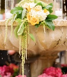 Stone fountain wedding decoration with yellow rose and white hydrangea