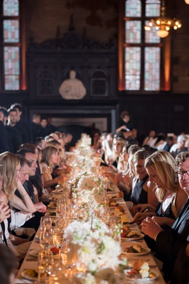 wedding reception hall high line hotel long table low centerpieces chandeliers historic building