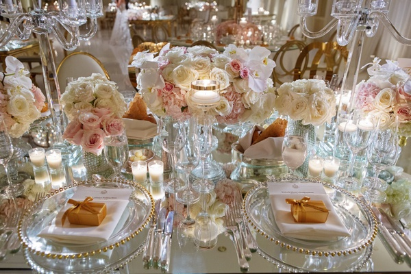 mirror wedding reception table gold beaded charger plate godiva chocolate favors floating candles