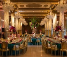 opulent and vast gold turquoise color palette with differing sizes of floral arrangements