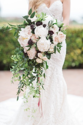 brimming cascading bouquet light dark flowers juxtapose arrangement vines roses black greenery blush
