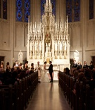 Bride in Monique Lhuillier dress and groom in tux at St. James Chapel in Chicago