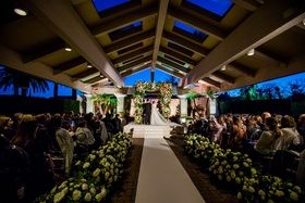 wedding ceremony bride groom under chuppah brentwood country club los angeles peach ivory greenery