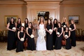 Jennifer Stone with bridesmaids in long black bridesmaid dresses by Jill Stuart