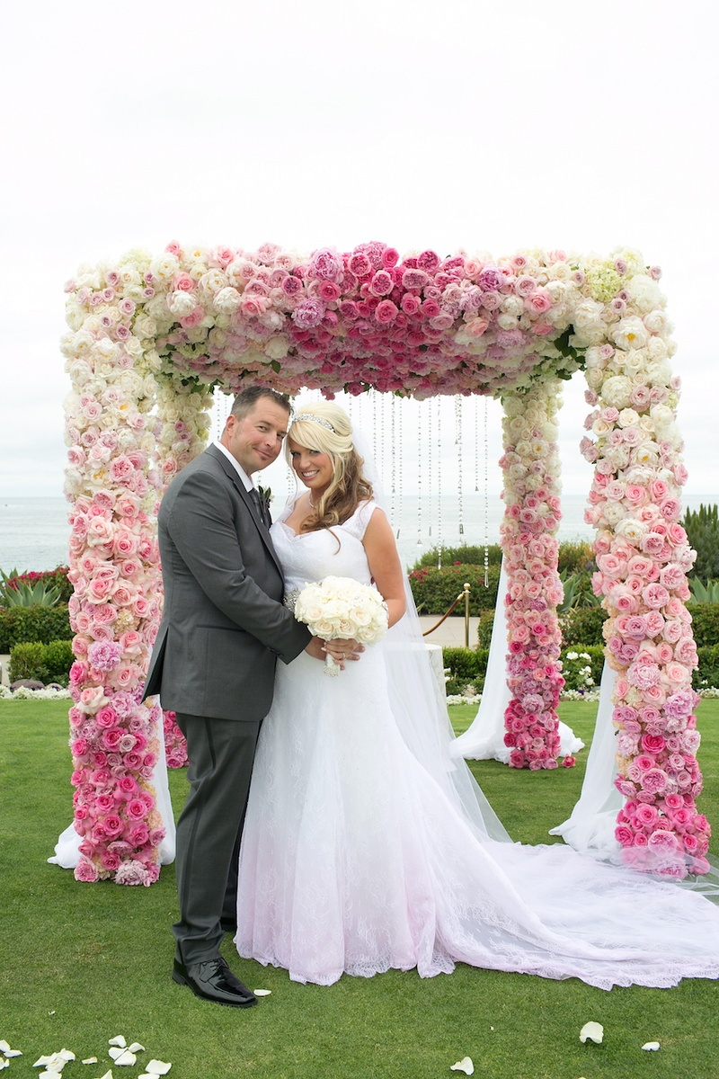Groom in grey suit and bride in pink dress at Montage Laguna Beach