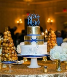 Wedding cake with gold tier and croquembouche