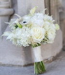 White rose, calla lily, hydrangea, and anemone wedding bouquet
