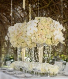 Styled shoot with white orrchid, ivory rose and hydrangea arrangement