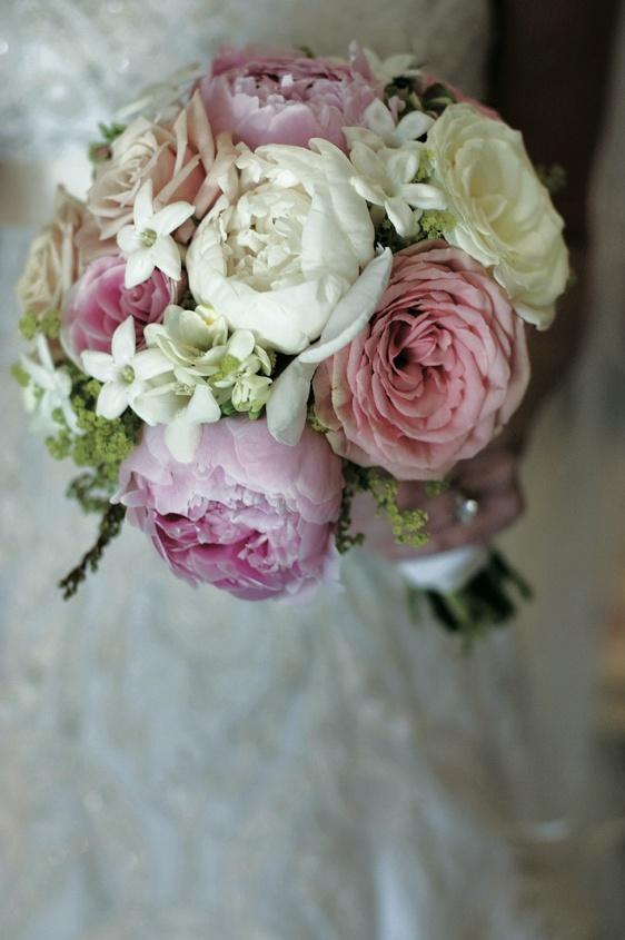 Bride carrying stephanotis and peony flowers