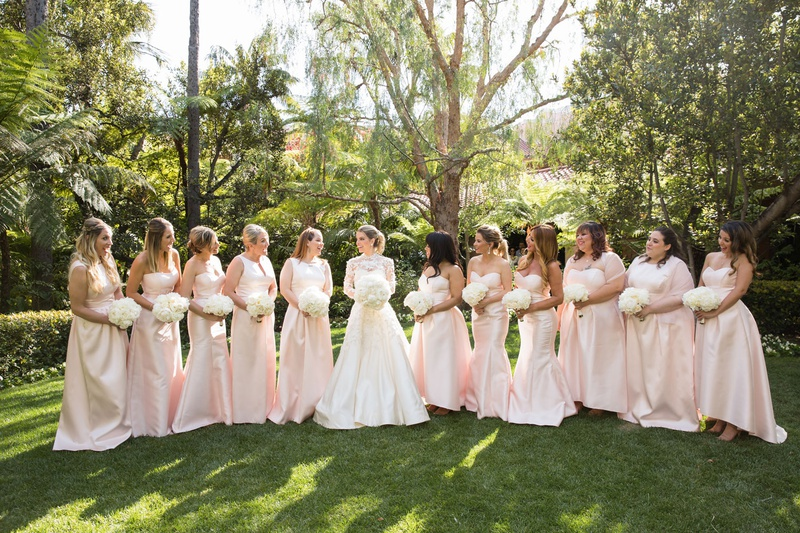 Light pink mismatched long bridesmaid dresses white bouquets alfred sung bride in marchesa