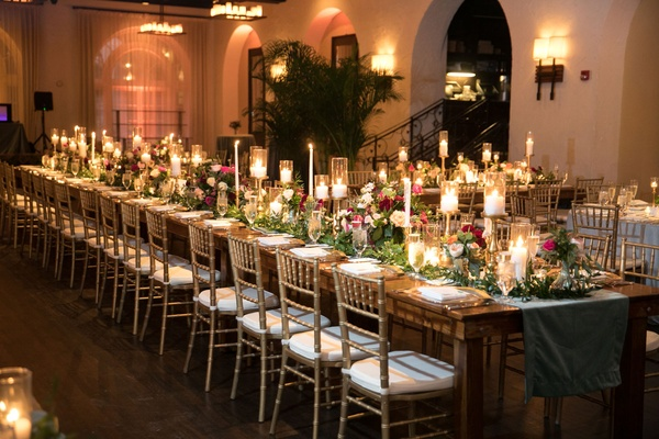 Wedding reception key west, florida with wood table and greenery runner head table gold candles