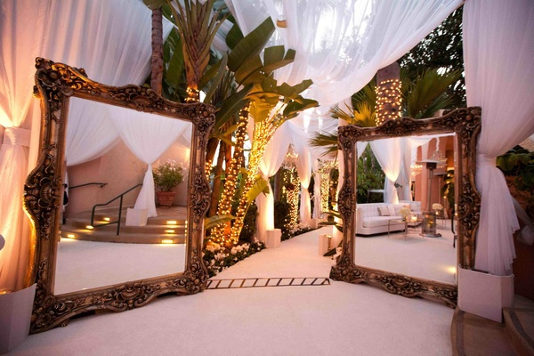 Two large mirrors at wedding reception entrance