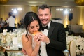 Bride eating in n out burger at wedding reception favors late night snack