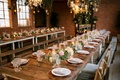 Wedding reception rustic chic rose gold copper low flower arrangements flower chandelier wood tables