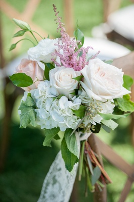 Garden wedding ceremony with peach, white roses, white hydrangeas, astilbe, greenery, lace