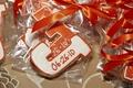 Orange letterman jacket initial wedding cookie favors