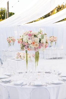 wedding reception all white space with floral centerpiece with shades of white and pink