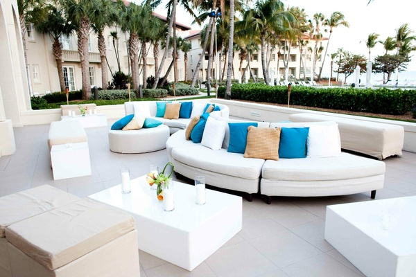 Oceanfront lounge area with white modern furniture