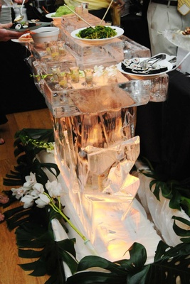 Ice sculpture bar for sushi station at wedding reception