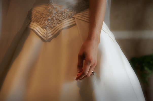 A-line wedding dress with diamond ring
