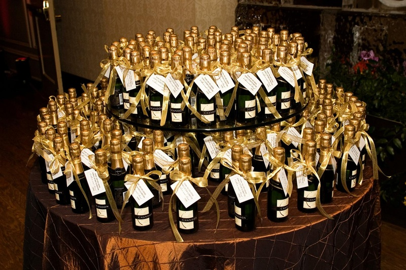 Favors & Gifts Photos - Champagne Bottle Favor Display - Inside Weddings