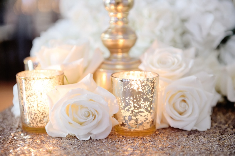 ... White Rose On Top Of Gold Sequin Tablecloth At Wedding Table ...