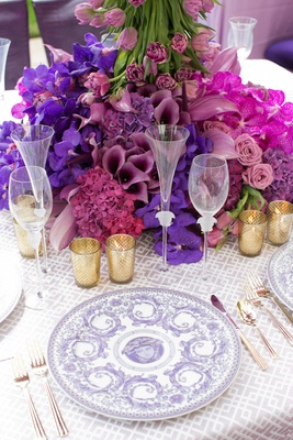 Wedding reception table place setting with lavender Versace Le Grand Divertissement service plate