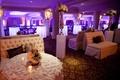 Purple wedding reception lighting in formal lounge area
