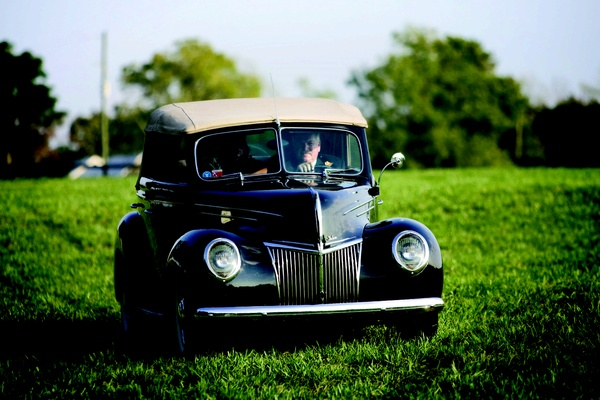 Black antique ford takes bride to ceremony