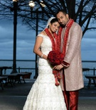 Indian woman wearing bridal gown and man in sherwani