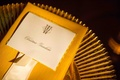 Golden yellow napkin with white escort card