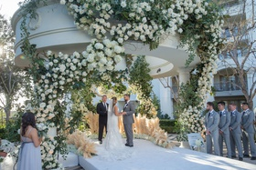 wedding ceremony gazebo pampas grass white flowers greenery raised aisle outdoor ceremony decor idea