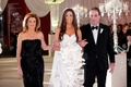 Jennifer Stone at wedding escorted by mother of the bride in black dress and father of the bride