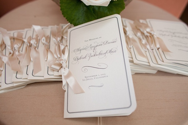 Modern calligraphy ceremony booklets tied with ribbon