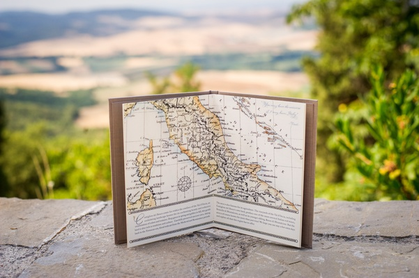 Hardbound booklet opened to a map of Italy