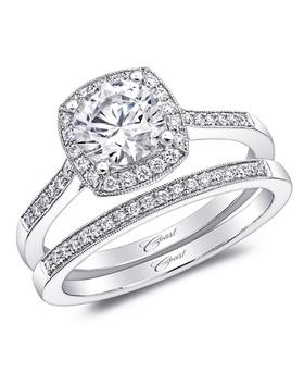 Cushion halo around round-cut diamond with pave shank