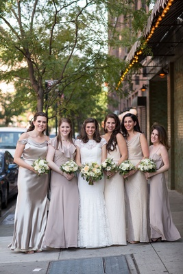 Bride in lace wedding dress from Mark Ingram Atelier with champagne pink pale purple taupe dresses